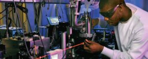 Student working with a laser