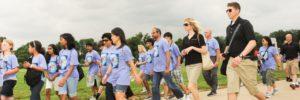 AEOP Volunteers walking with students